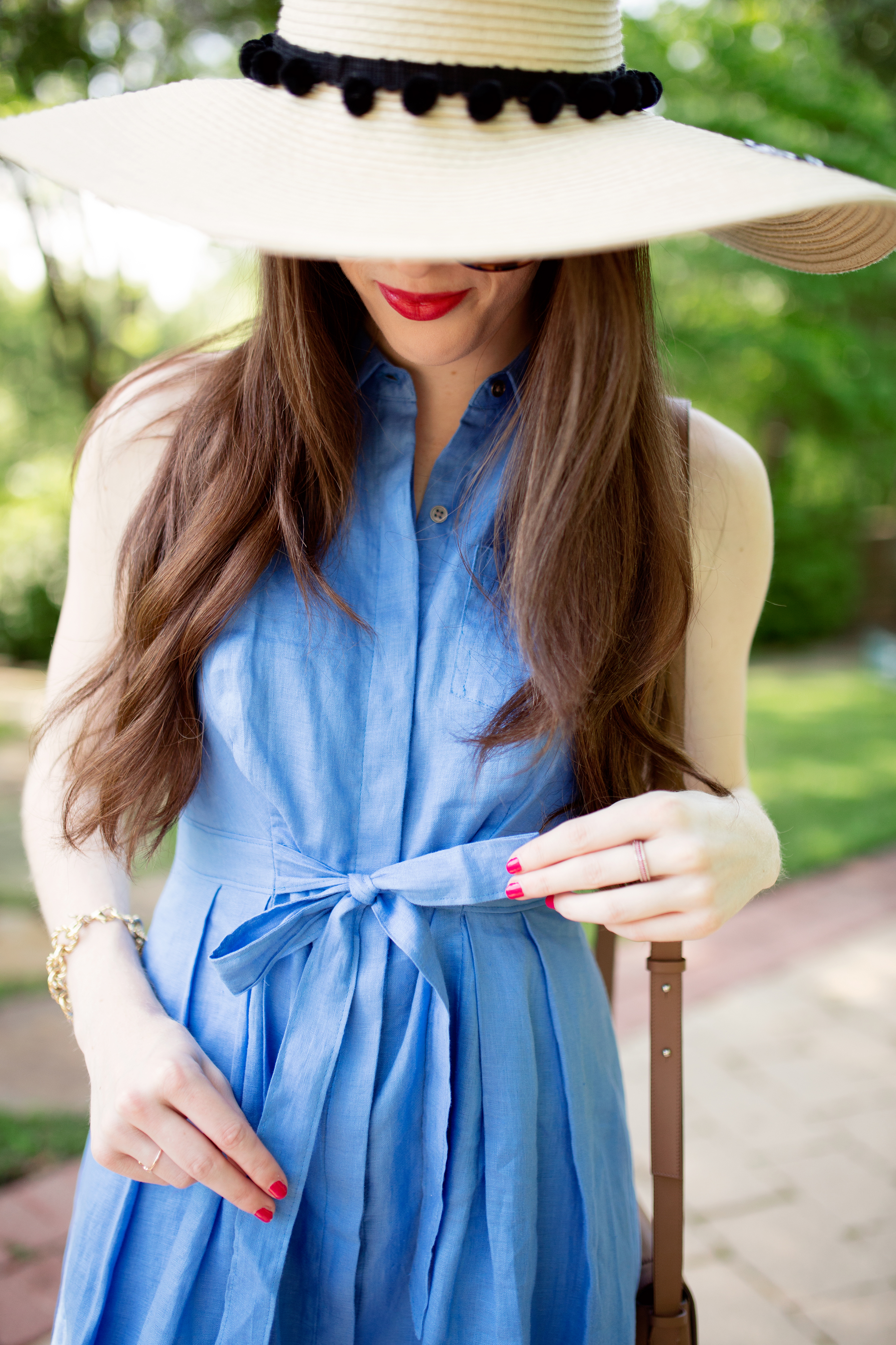Blue shirtdress with a bow