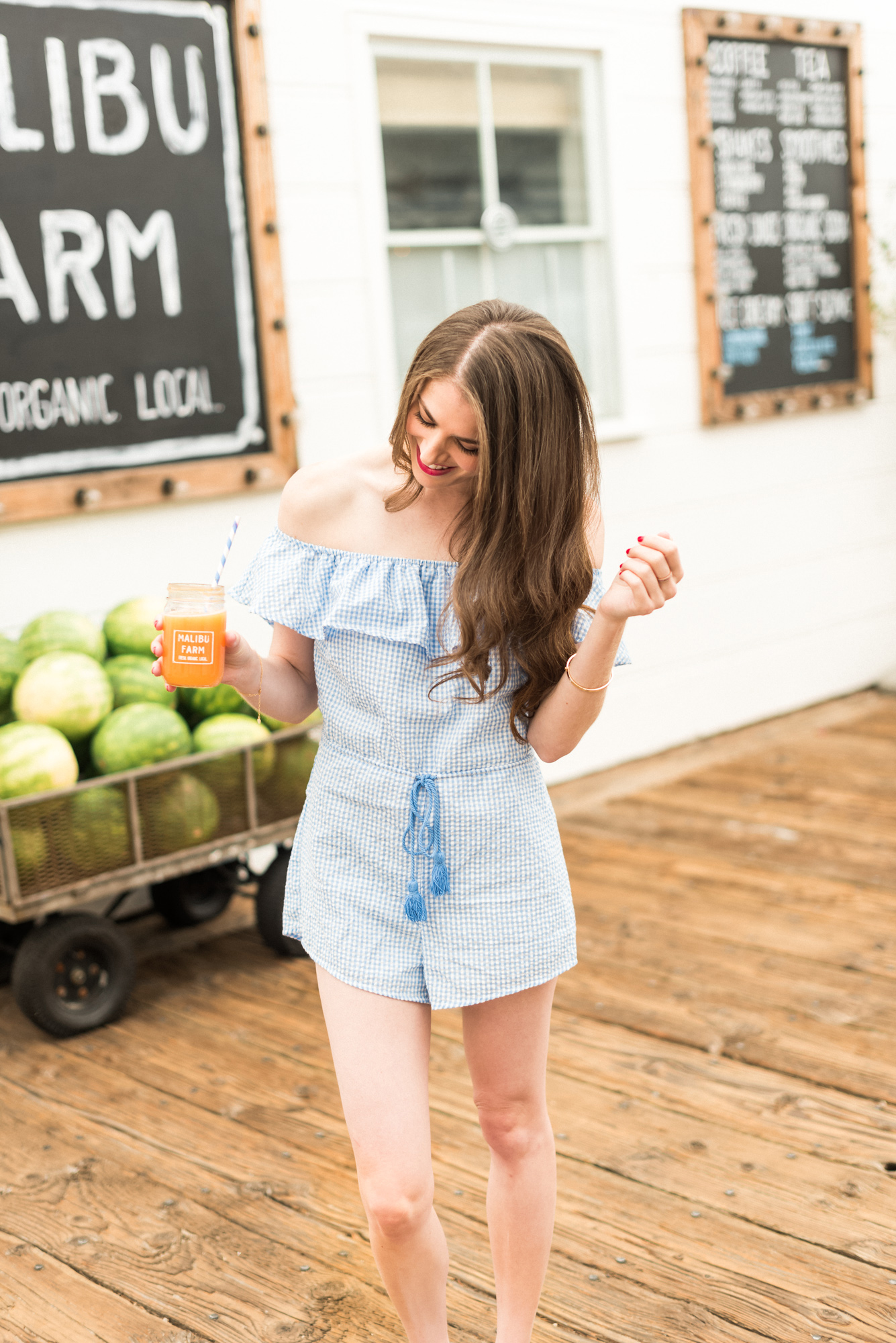Blue and white gingham romper with front tie
