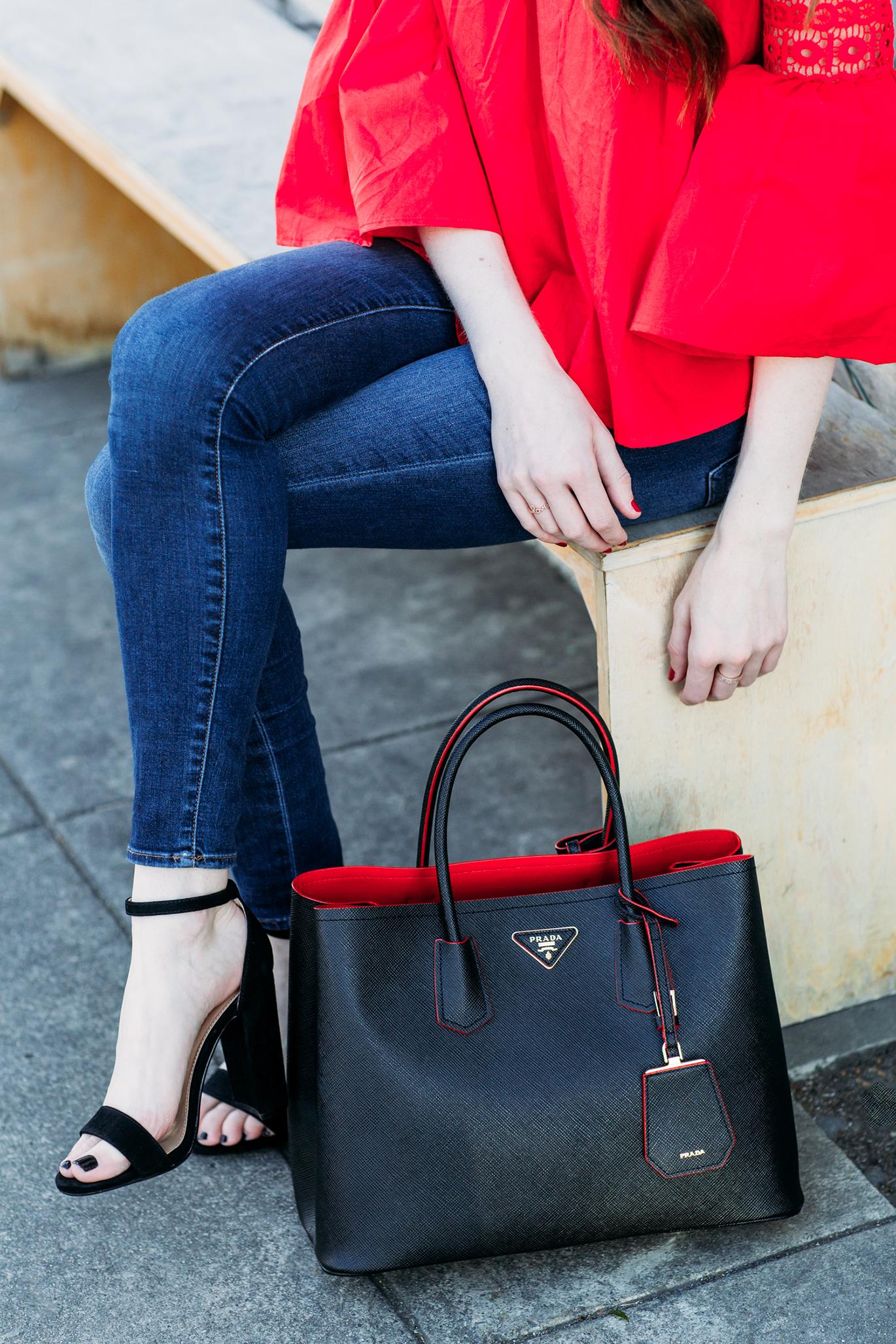 Black Prada purse with red lining